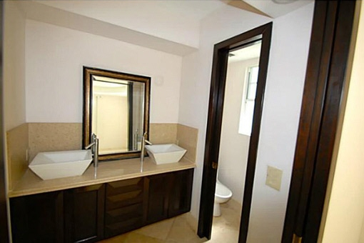 A bathroom with ebonized cherry wood and marble