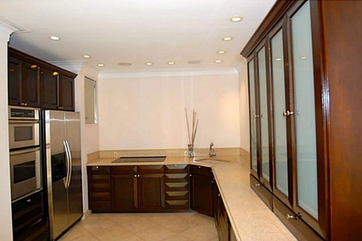 The brand new kitchen with its stainless gourmet and recessed lighting