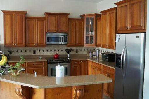 Kitchen with cherry cabinetry