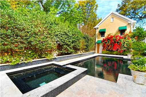 Beautiful swimming pool surrounded by garden