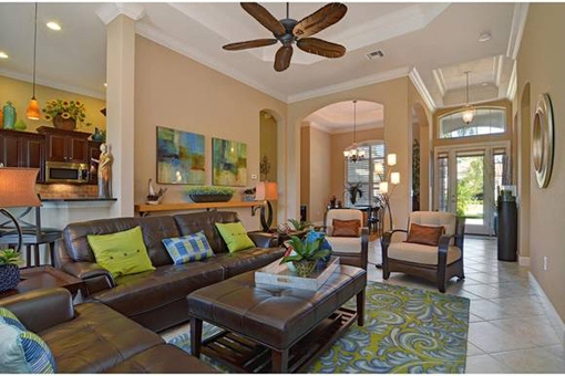 Luxurious living room with ceiling fan in Fort Myers