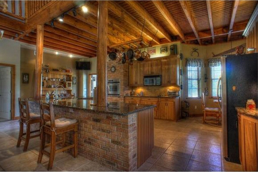 Kitchen with breakfast bar and cooking island