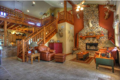 Living room with fireplace and staircase