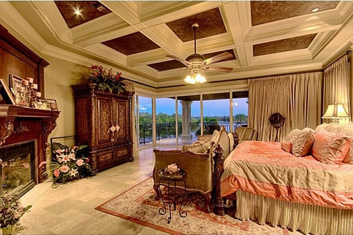 One of the master bedroom with a fireplace